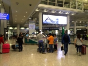 Passing into the public area of the terminal. the rail link is again central to onward navigation